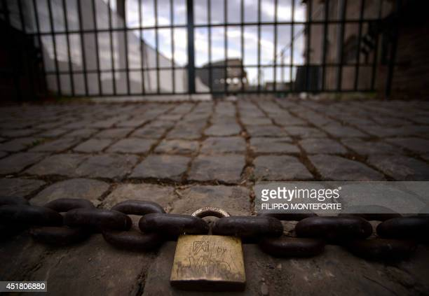 A fence and a chain close access to a construction site near the Colosseum during its restoration funded by Italian brand 'Tod's' on July 4 2014 in...