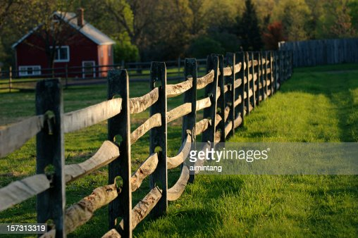 Fence and red House