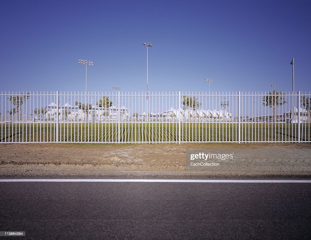 Fence and traditional tented grandstand at circuit : Stock Photo