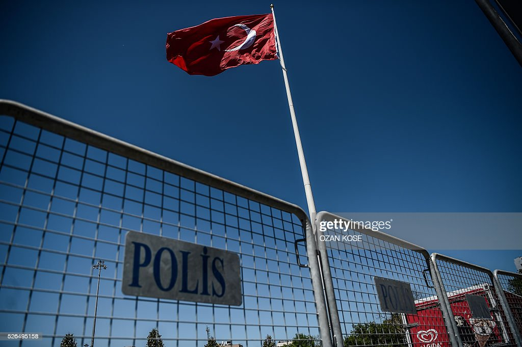 A fence set as part of the security measures for May day is pictured, April 30, 2016 at the Taksim square in Istanbul. Istanbul braced for a major security lockdown for May Day on Sunday, with almost 25,000 police on duty and numerous roads closed for an occasion that regularly sees clashes between Turkish protesters and police. / AFP / OZAN