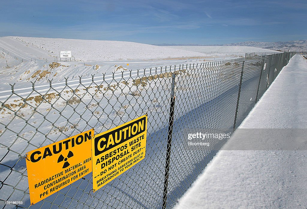 A fence stands to keep people away from a completed cap where low level radioactive waste is buried and stored at the EnergySolutions Inc. low level radioactive waste disposal site in Clive, Utah, U.S., on Wednesday, Jan. 9, 2013. EnergySolutions Inc. obtained a commitment from Morgan Stanley to provide a senior secured credit facility to back its $1.1 billion buyout by Energy Capital Partners LLC. Photographer: George Frey/Bloomberg via Getty Images