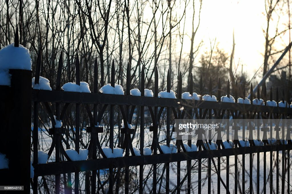 fence with spikes sun : Stock Photo