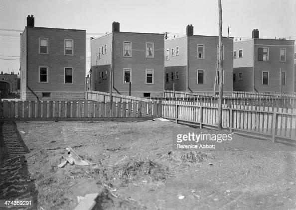 Fenced backyards of row houses Newark New Jersey circa 1933