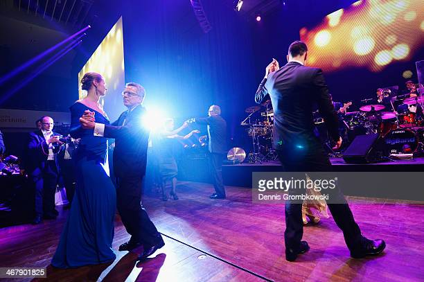 Fencer Britta Heidemann and Minister of State Affairs Thomas de Maiziere dance at the opening of Ball des Sports 2014 at RheinMainHalle on February 8...