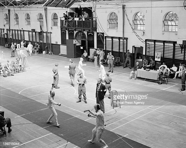 Fencers competing in the second leg of the modern pentathlon event at Aldershot Hampshire during the Olympic Games 31st July 1948