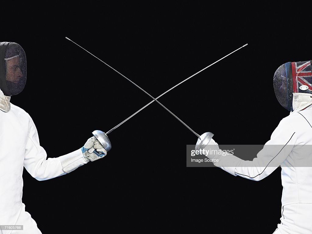 Fencers crossing foils : Stock Photo