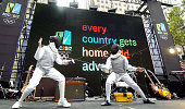 Fencers display their skills before a crowd gathered to show support for New York's bid for the 2012 Summer Olympic Games at Rockefeller Plaza All...