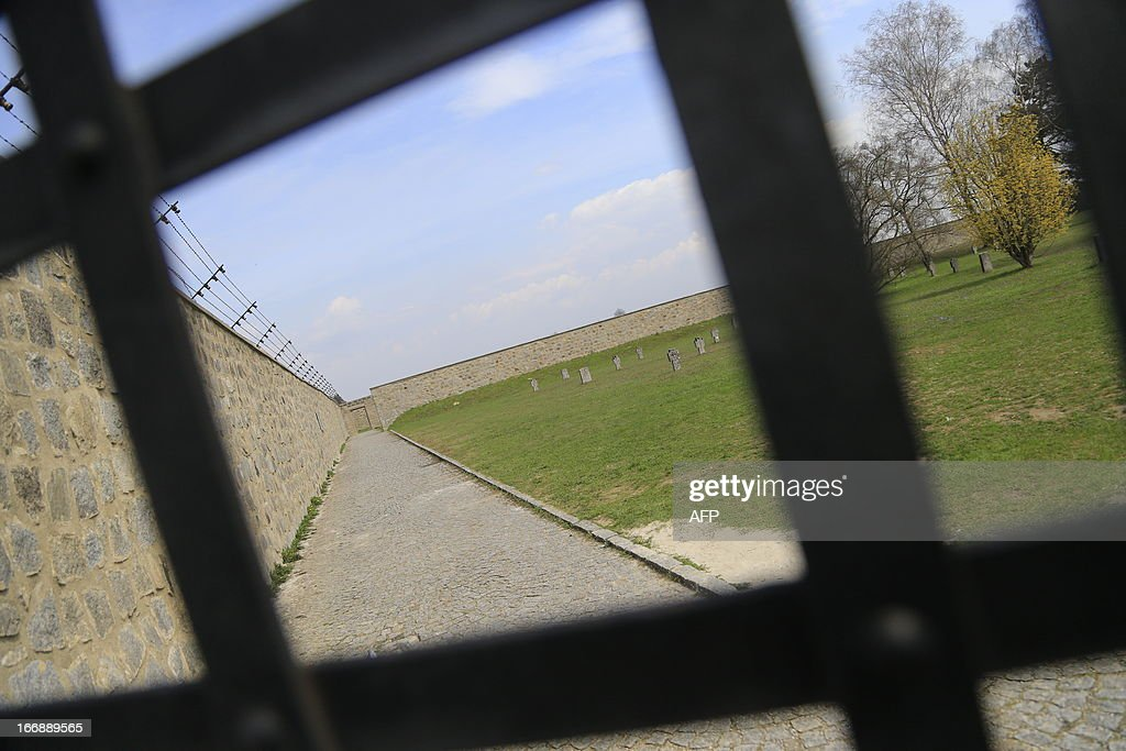Fences and walls with barbed wires are seen at World War II concentration camp of Mauthausen, on April 17, 2013.