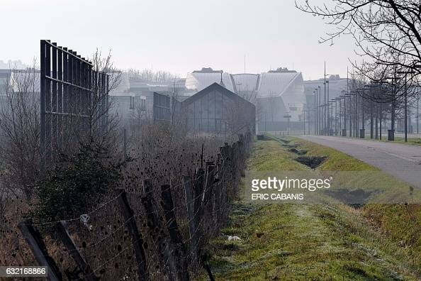 Fences are pictured at the site of the former chemical factory AZF in Toulouse southern France on January 20 2017 Who is responsible for the disaster...