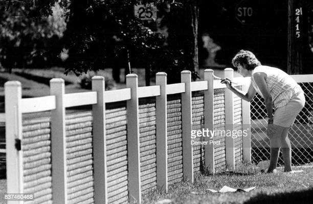 Fences Tuesday was a nice day to paint fences at least that is how Mrs George Makris felt as sht spent the day painting the fence that surrounds her...