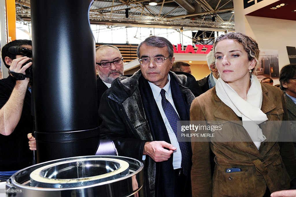 Fench Ecology minister Delphine Batho (R) and head of Rhone Alpes regional council Jean-Jack Queyranne visit the fair for sustainable energy during its inauguration on February 19, 2013 in Chassieu, near Lyon.
