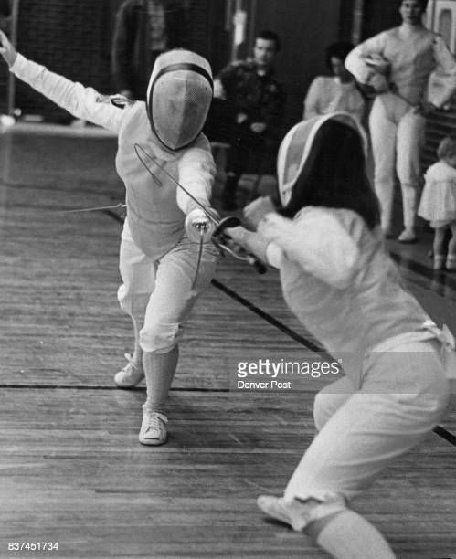 Fencing A point for the Challenger Terry Pressman of Palo Alto Calif scores a touch in her match against Colorado women's champion Mrs Iris Lucero of...