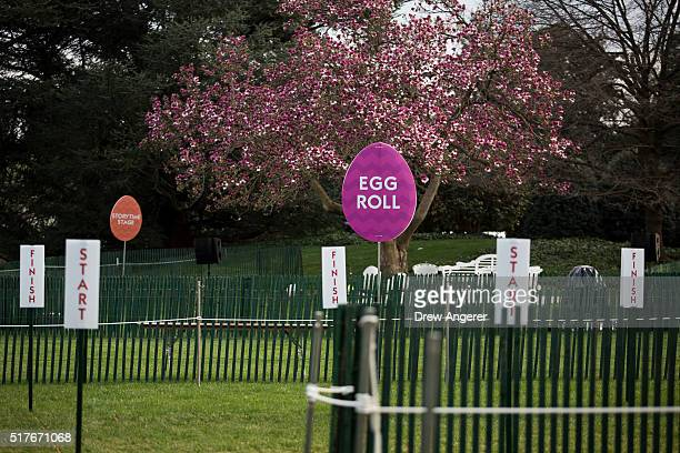 Fencing and signage for Monday's Easter Egg Roll is set up on the South Lawn of the White House March 26 2016 in Washington DC President Obama played...
