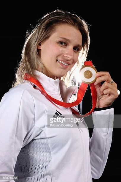 Fencing gold medalist Britta Heidemann poses with her medal during a portrait session at the fencing training hall on August 16 2008 in Beijing China