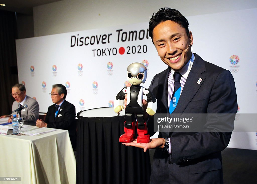 Fencing Olympic silver medalist <a gi-track='captionPersonalityLinkClicked' href=/galleries/search?phrase=Yuki+Ota&family=editorial&specificpeople=2956051 ng-click='$event.stopPropagation()'>Yuki Ota</a> pose for photographs with the robot Mirata during a press conference at the Hilton Hotel on September 4, 2013 in Buenos Aires, Argentina.