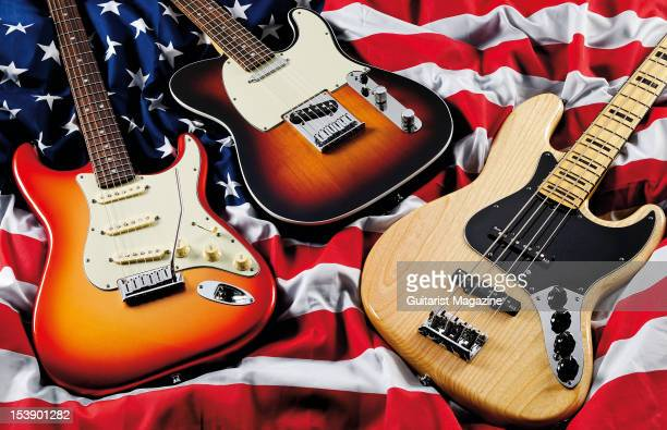 Fender American Deluxe Stratocaster Telecaster and Jazz Bass electric guitars during a studio shoot for Guitarist Magazine October 27 2010