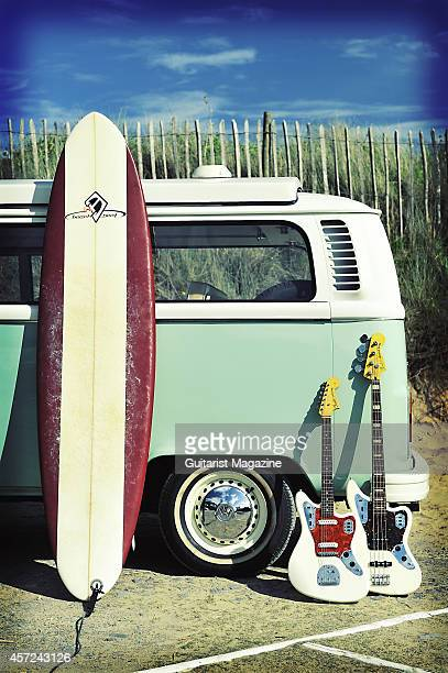 A Fender Jaguar electric guitar and bass photographed with a surf board and Volkswagen Camper van for a feature on surf rock taken on July 1 2011