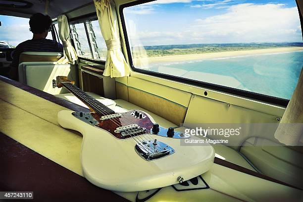 A Fender Jaguar electric guitar photographed with a surf board in the back of a Volkswagen Camper van for a feature on surf rock taken on July 1 2011
