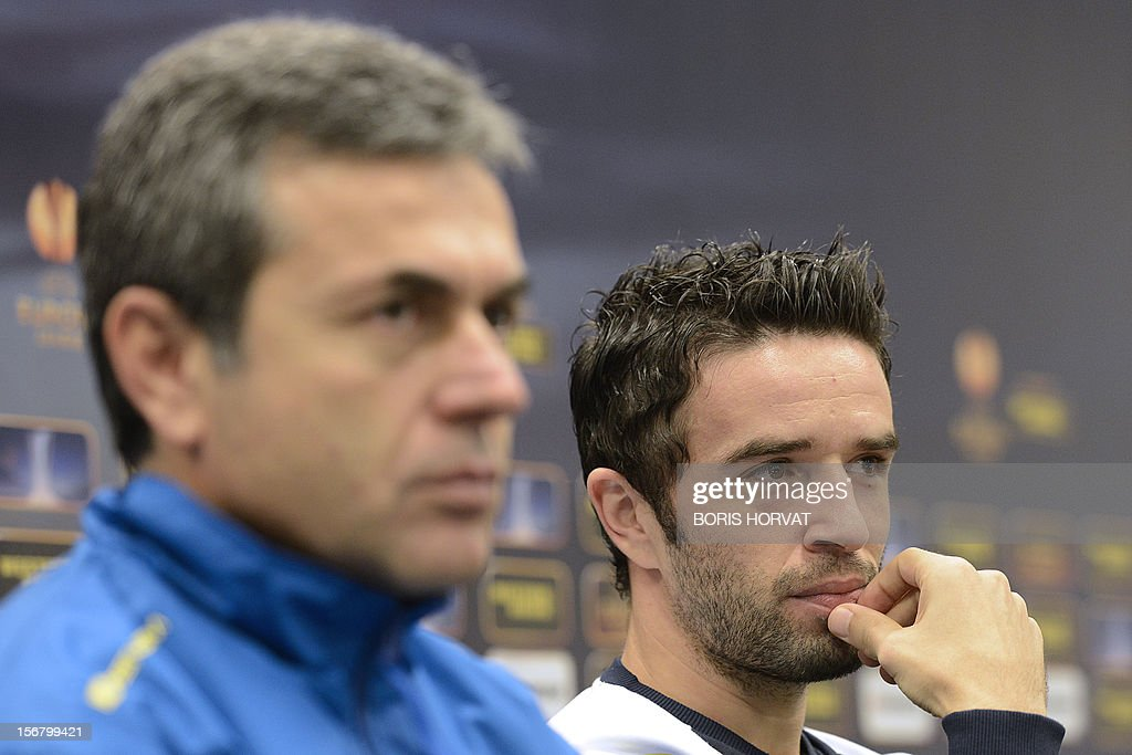 Fenerbahce defender Gokhan Gonul (R) and head coach Aykut Kocaman (L) give a press conference on November 21, 2012 at the Velodrome stadium in Marseille, on the eve of a UEFA Europa League qualifying match against Marseille.