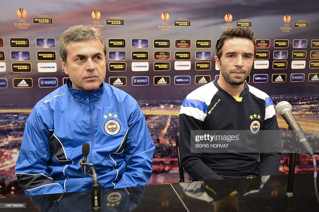 Fenerbahce defender Gokhan Gonul (R) and head coach Aykut Kocaman (L) give a press conference on November 21, 2012 at the Velodrome stadium in Marseille, on the eve of a UEFA Europa League qualifying match against Marseille. AFP PHOTO / BORIS HORVAT