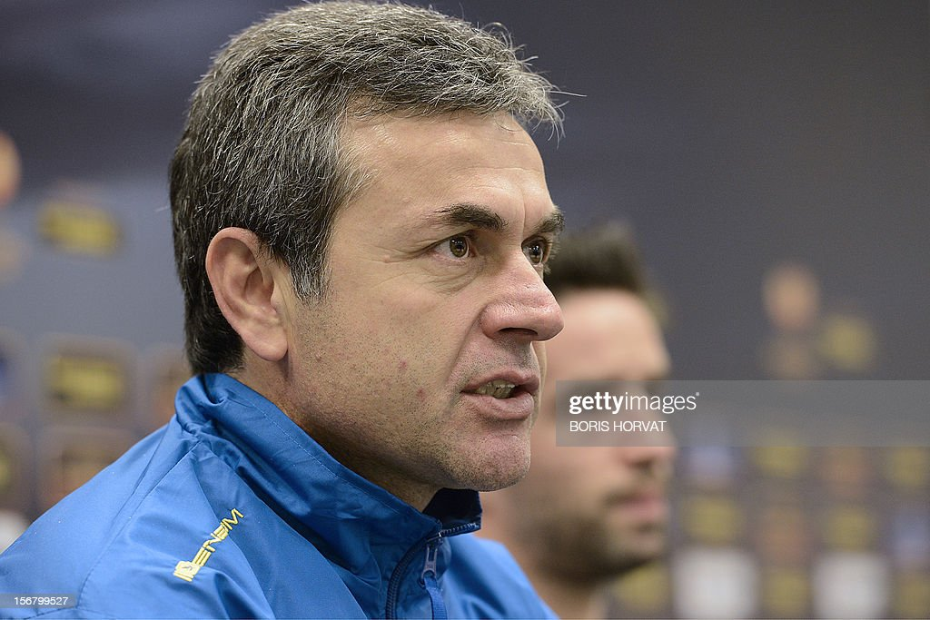 Fenerbahce head coach Aykut Kocaman (L) gives a press conference on November 21, 2012 at the Velodrome stadium in Marseille, on the eve of a UEFA Europa League qualifying match against Marseille.