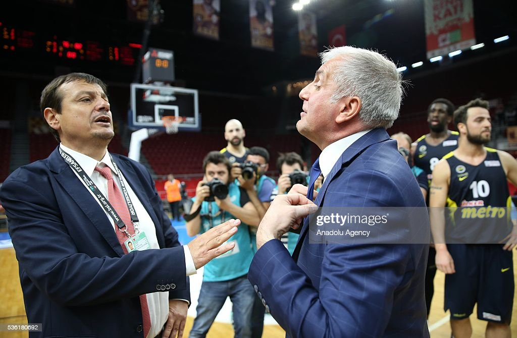 Fenerbahce head coach Zeljko Obradovic (L) and Galatasaray Odeabank head coach Ergin Ataman (R) talk to each other after the Turkish Spor Toto Basketball League play-offs semi-final match between Galatasaray Odeabank and Fenerbahce at Abdi Ipekci Sports Hall in Istanbul, Turkey on May 31, 2016.
