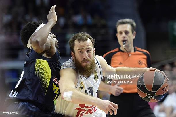 Fenerbahce Istambul's US guard Bobby Dixon vies with Real Madrid's guard Sergio Rodriguez during the Euroleague Game 3 playoff match Real madrid vs...