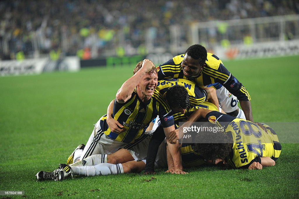 Fenerbahce players celebrate after scoring during an UEFA Europa League semi-final football match between Fenerbahce and Benfica at Sukru Saracoglu stadium on April 25, 2013 in Istanbul.