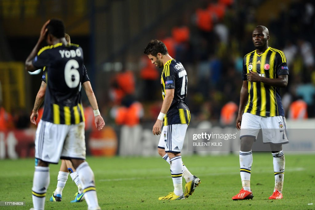 Fenerbahce players react after their match with Arsenal during their UEFA Champions League Play Off first leg match at Sukru Saracoglu Stadium in Istanbul on August 21, 2013. AFP PHOTO/BULENT KILIC
