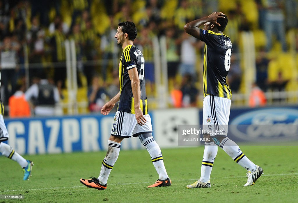 Fenerbahce players react after their UEFA Champions League Play Off first leg match against Arsenal at Sukru Saracoglu Stadium in Istanbul on August 21, 2013.