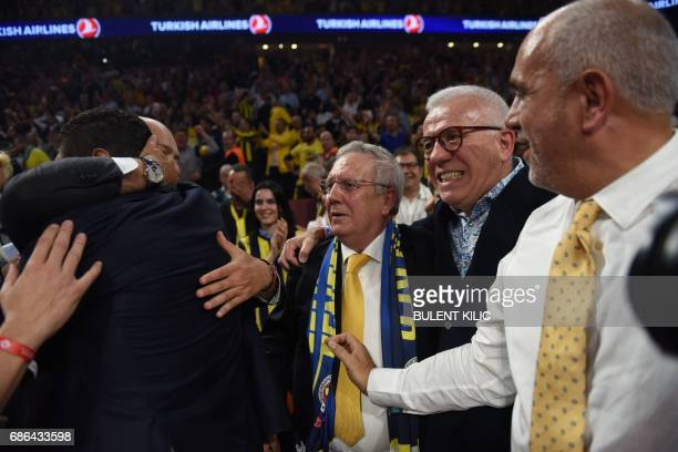 Fenerbahce president Aziz Yildirim and Hurriyet daily journalist Ertugrul Kurkcu reacts after Fenerbahce won the first place basketball match between...