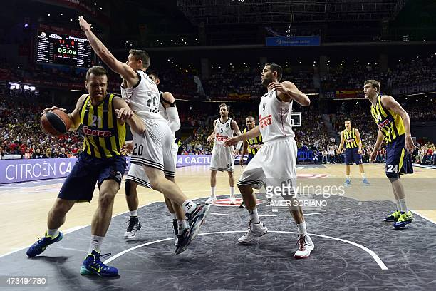 Fenerbahce Ulker's center Oguz Savas vies with Real Madrid's US guard Jaycee Carroll during the Euroleague Final Four basketball semifinal match Real...