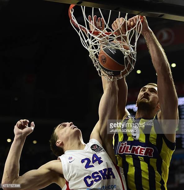 Fenerbahce Ulker's center Semih Erden scores in front of CSKA Moscow's center Sasha Kaun during the Euroleague Final Four basketball third place game...