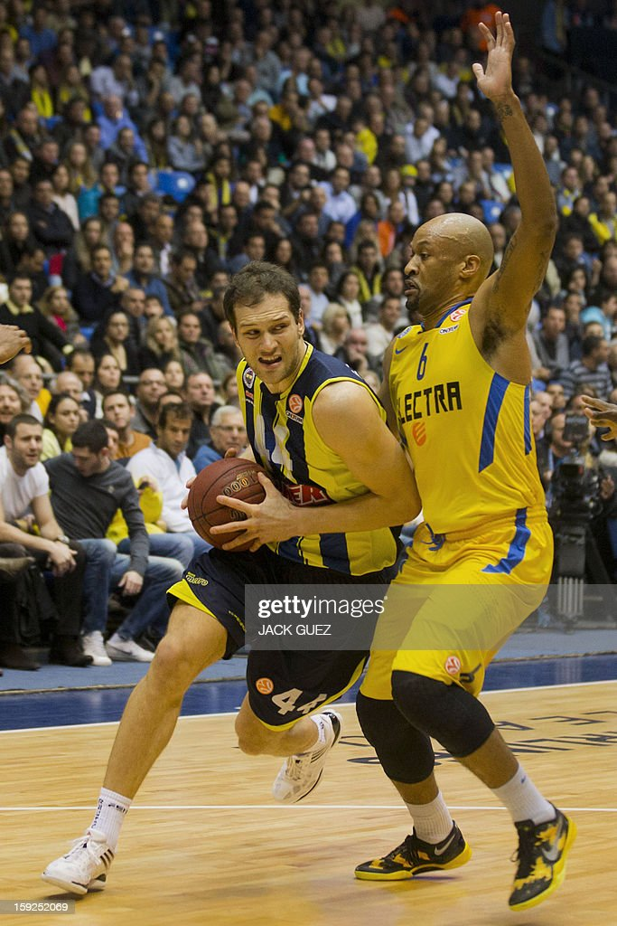 Fenerbahce Ulker's Croatian forward Bojan Bogdanovic (L) vies with Maccabi Tel Aviv's guard Devin Smith (R) of the US during their Euroleague top 16 basketball match on January 10, 2013, at the Nokia stadium in the Mediterranean coastal city of Tel Aviv.