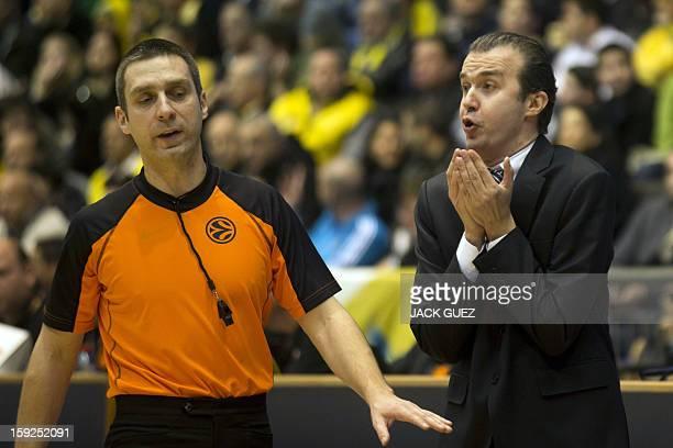 Fenerbahce Ulker's Head Coach Simone Pianigiani reacts during his team's Euroleague top 16 basketball match against Maccabi Tel Aviv on January 10 at...