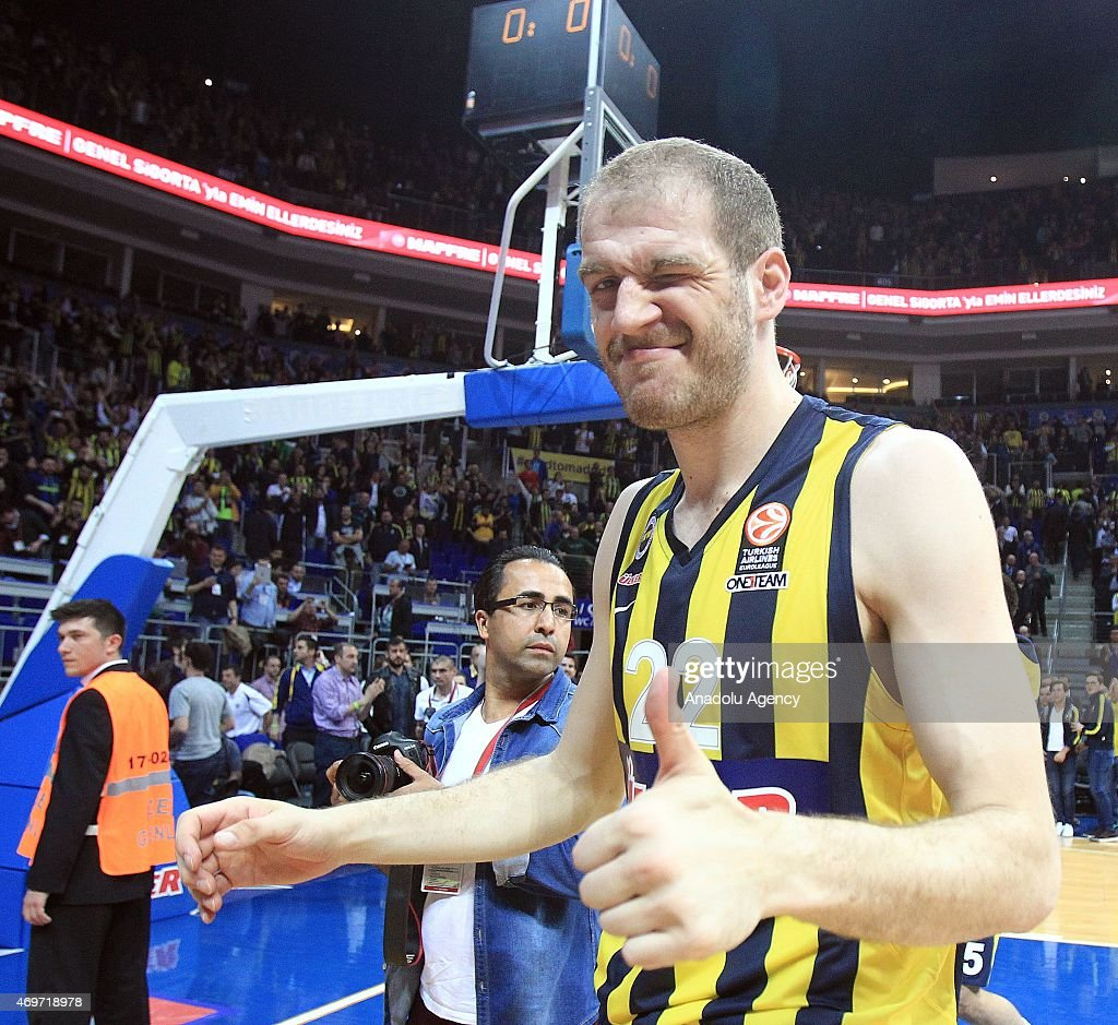 Fenerbahce Ulker's player Luka Zoric (22) celebrates the score after the Turkish Airlines Euroleague playoffs round 1 basketball match against Maccabi Tel Aviv at Fenerbahce Ulker Sports Arena in Istanbul on April 14, 2015.