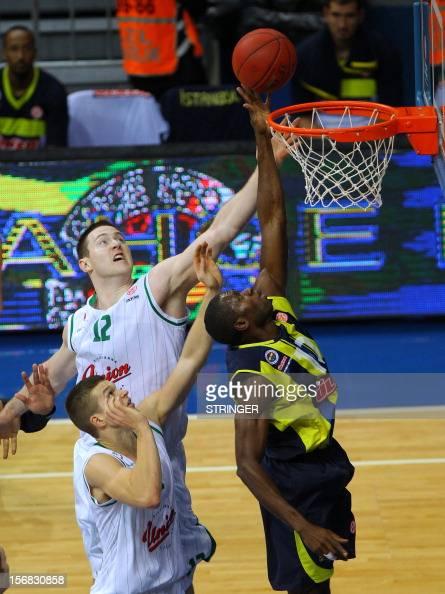 Fenerbahce Ulker's Romain Sato dunks the ball as Union Olimpija`s Aron John Baynes attempts to block him during the Euroleague basketball match...