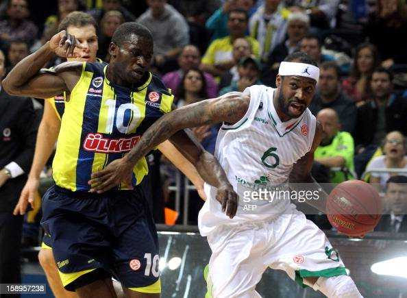 Fenerbahce Ulker`s Romain Sato vies with Montepaschi Siena`s Bobby Brown during their Euroleague basketball match between at the Ulker Sport Hall in...
