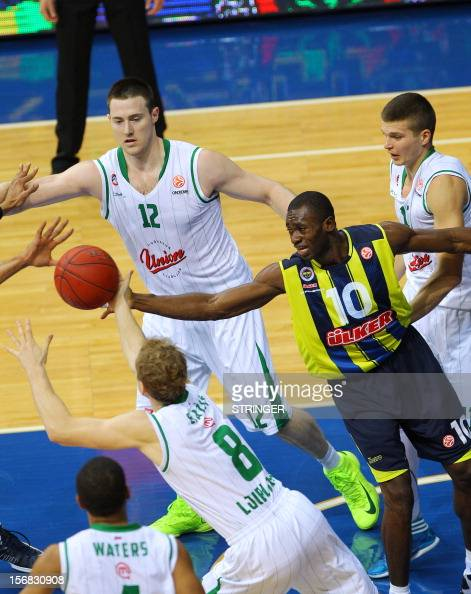Fenerbahce Ulker's Romain Sato viess for the ball with Union Olimpija`s players during the Euroleague basketball match between Fenerbahce Ulker and...