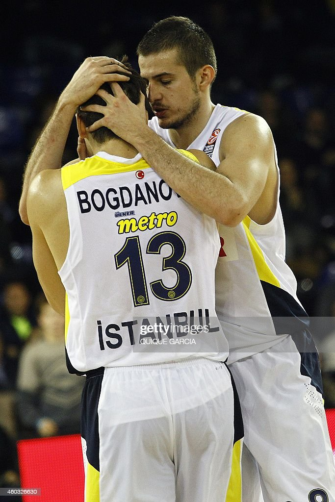 Fenerbahce Ulker's Serbian forward Nemanja Bjelica (R) and Fenerbahce Ulker's Serbian guard Bogdan Bogdanovic (L) during the Euroleague group C basketball match FC Barcelona vs Fenerbahce Ulker Istanbul at the Palau Blaugrana sportshall in Barcelona on December 11, 2014.