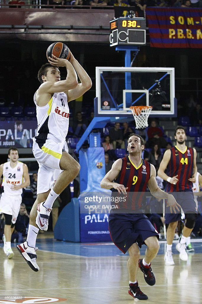 Fenerbahce Ulker's Serbian guard Bogdan Bogdanovic (L) vies with Barcelona's Brazilian guard <a gi-track='captionPersonalityLinkClicked' href=/galleries/search?phrase=Marcelinho+Huertas&family=editorial&specificpeople=740271 ng-click='$event.stopPropagation()'>Marcelinho Huertas</a> (R) during the Euroleague group C basketball match FC Barcelona vs Fenerbahce Ulker Istanbul at the Palau Blaugrana sportshall in Barcelona on December 11, 2014.