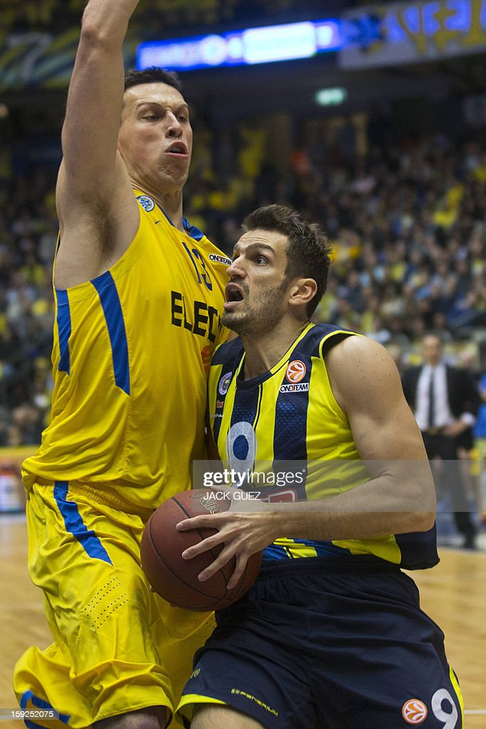Fenerbahce Ulker's Turkish guard Baris Ermis (R) vies with Maccabi Tel Aviv's Georgian center Giorgi Shermadini (L) during their Euroleague top 16 basketball match on January 10, 2013, at the Nokia stadium in the Mediterranean coastal city of Tel Aviv.