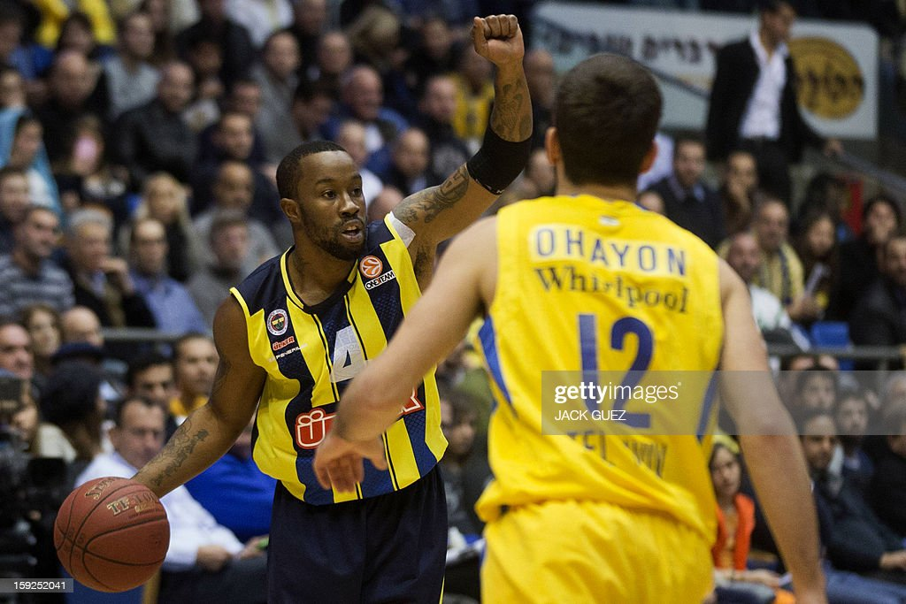 Fenerbahce Ulker's US guard Bo McCalebb (L) vies with Maccabi Tel Aviv's Israel guard Yogev Ohayon (R) during their Euroleague top 16 basketball match on January 10, 2013, at the Nokia stadium in the Mediterranean coastal city of Tel Aviv.