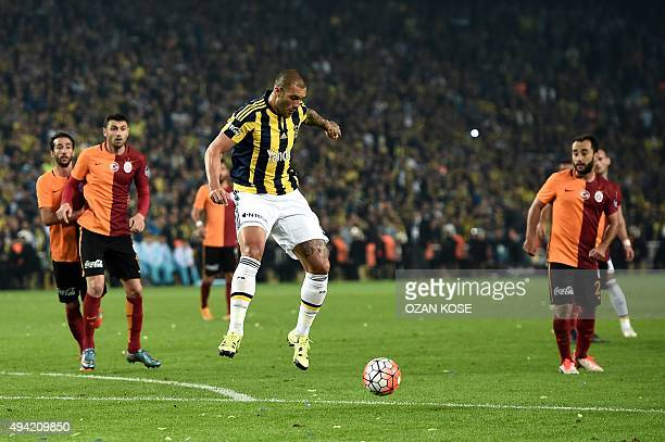 Fenerbahce's Brazilian forward Fernandao controls the ball next to Galatasaray's Turkish forward Burak Yilmaz and Turkish midfielder Olcan Adin...