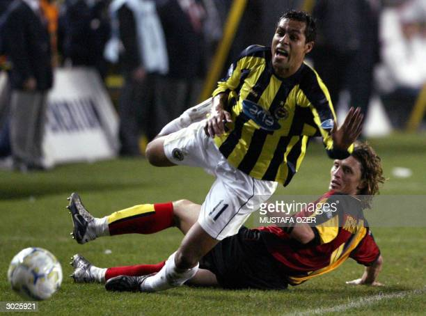 Fenerbahce's Brazilian Marcio Nobre fights for the ball with Galatasaray's Orhan Ak during their Turkish Super League football match at Sukru...