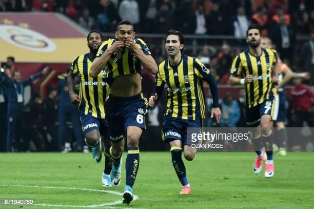 Fenerbahce's Brazilian midfielder Josef de Souza celebrates after scoring a goal during the Turkish Super Lig football match between Galatasaray and...