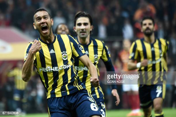 Fenerbahce's Brazilian midfielder Josef de Souza celebrates after scoring a goal during the Turkish Super Lig football match between Galatasaray and...