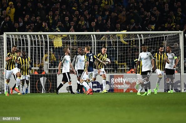 Fenerbahce's Brazilian midfielder Souza celebrates with teammates after scoring a goal during the UEFA Europa League round of 32 second leg football...