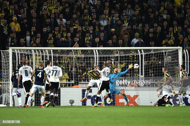 Fenerbahce's Brazilian midfielder Souza scores a goal during the UEFA Europa League round of 32 second leg football match between Fenerbahce SK and...