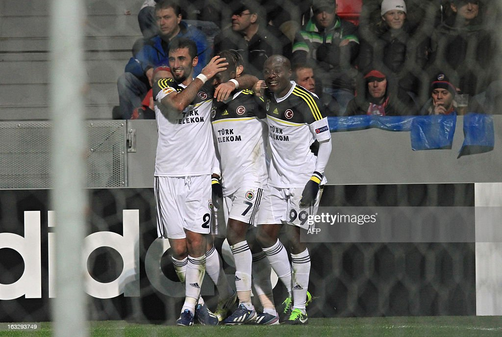 Fenerbahce's celebrate after a goal during the UEFA Europa League Round of 16 first leg football match FC Viktoria Plzen vs Fenerbahce SK in Plzen, Czech Republic, on March 7, 2013.
